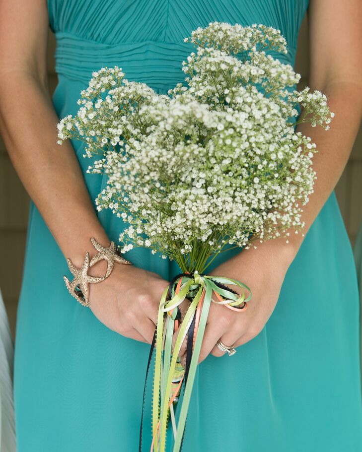 The bride and a few dedicated family members created the simple Baby's Breath bridesmaids bouquets. Colorful strands of thin ribbon tied the stems together.