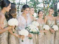 bridesmaids posing in gold beaded dresses