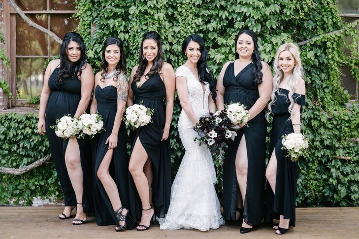 The bridesmaids wore long silky black gowns in varying styles to match the vintage-glam feel of Jeanne and Beau's wedding at the Vintage House in Yountville, California.
