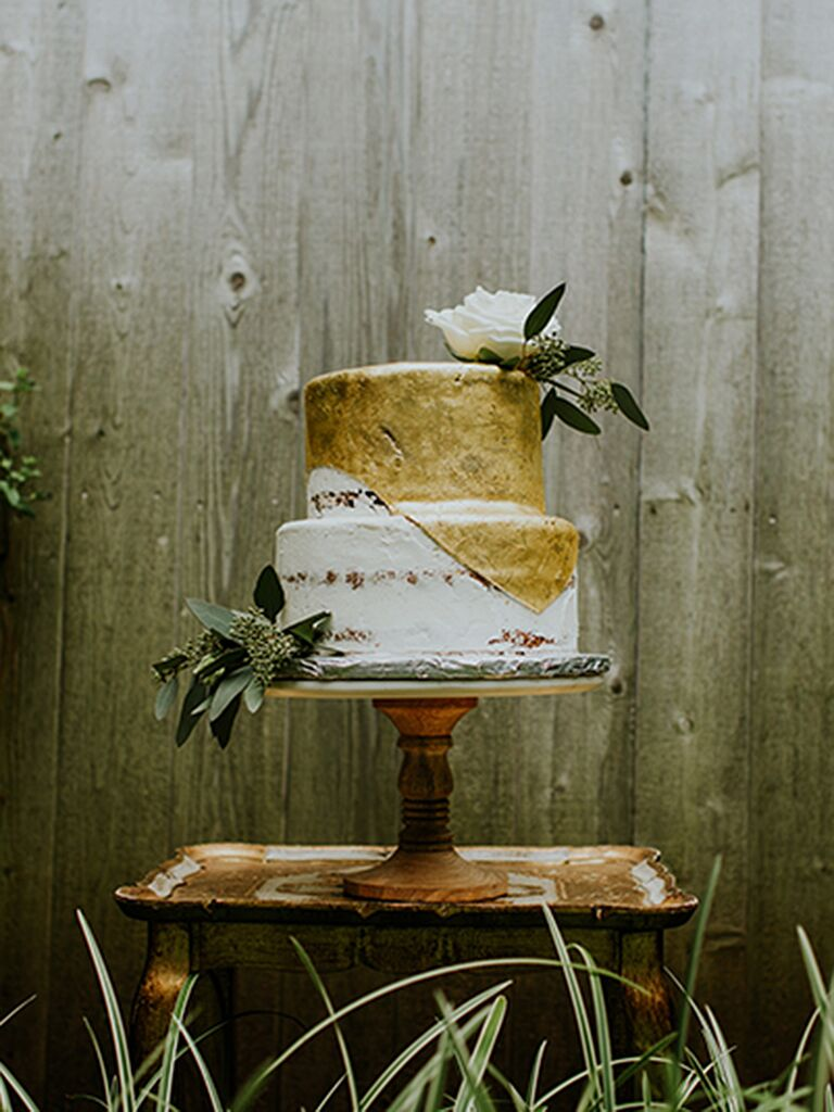 Rustic wedding cake with a gold fondant drip design