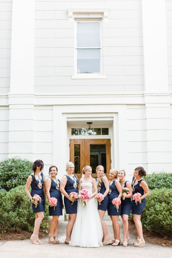 Intricate gold swirl trim on the notched neckline added chic charm to the navy Janice Shift bridesmaid dresses by Lilly Pulitzer. Each bridesmaid wore gold wedges with a gold bracelet engraved with her initials—a gift from Kelsey.
