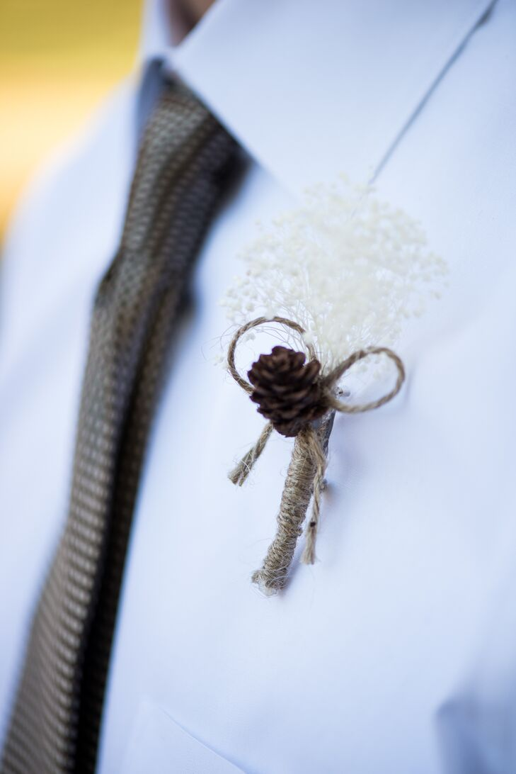 The groomsmen wore homemade boutonnieres of pinecones, twine and baby's breath.