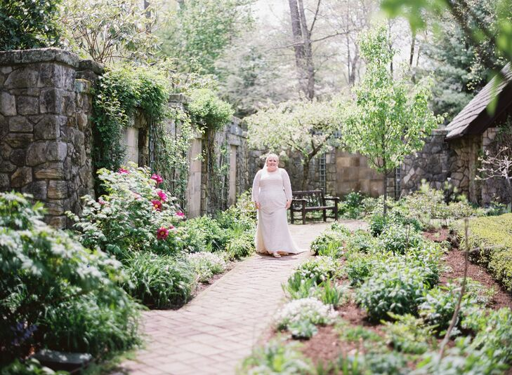 """I'm a plus-size bride with curves. With the vision of this soft romantic, whimsical and elegant 'Alice in Wonderland'-themed wedding, I needed a gown that would complement and duplicate the equivalent traits,"" Nicole says. She also wanted a gown that would match the style of the historic venue, and she found the perfect fit in a lace and ivory Oleg Casanni gown. ""I felt graceful and delicate,"" she says. ""It was serendipity."""