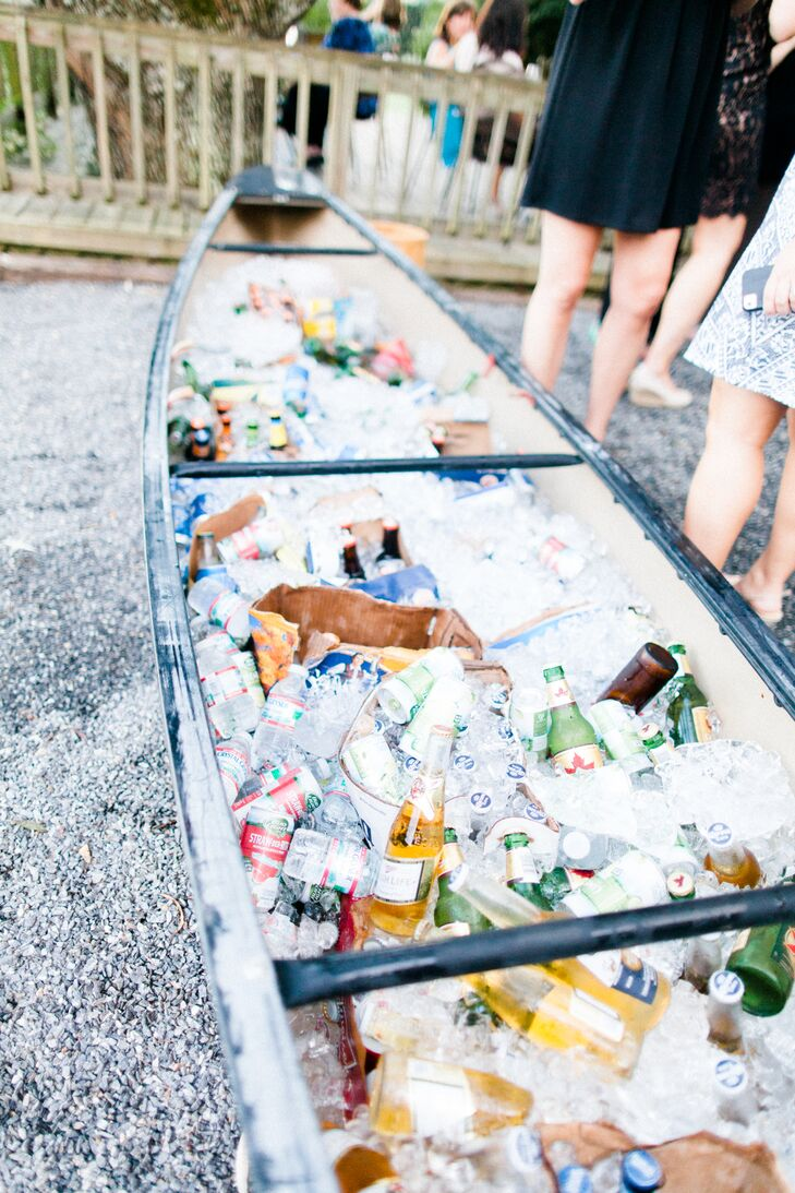 "After the ceremony, guests enjoyed a cocktail hour overlooking the vineyard with a wine bar and a beer canoe. ""The beer canoe was a definite favorite and if you have ever wondered how many beers it takes to fill up a canoe—it's 400!"" says Cory."