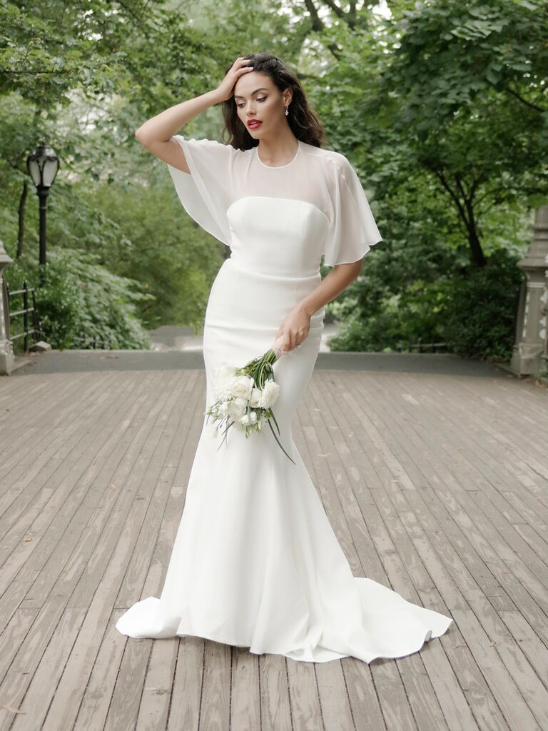 Catherine Kowalski Fall 2019 wedding dress with sheer flutter sleeves and a flared skirt
