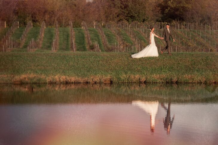 The Newlyweds Hold Hands in the Vineyard of the Villa Marie Winery