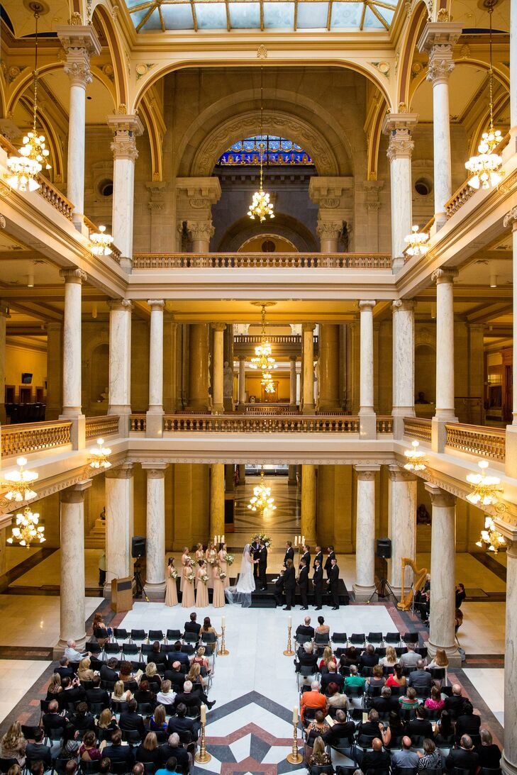 "The ceremony was in the rotunda of the Indiana State Capitol, a ""remarkably beautiful"" building. There wasn't much decorating required, since the building—with marble floors, grand pillars and intricate architecture—was gorgeous on its own."