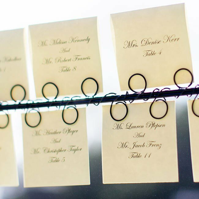Formal black and white escort cards informed guests of their table numbers.