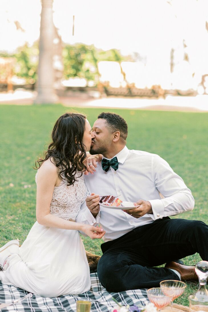 Couple Shares Kiss While Eating Cake During Boston Elopement