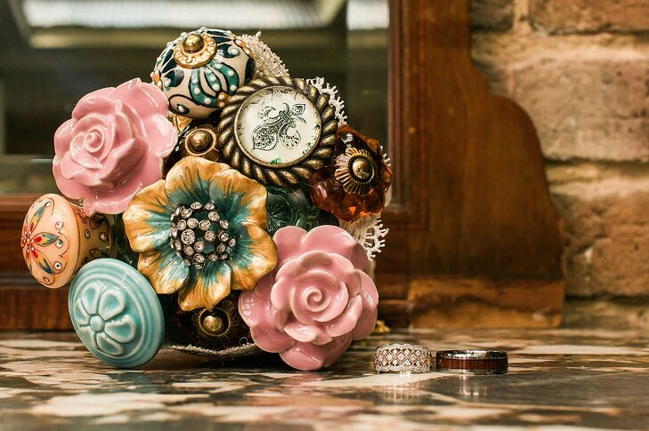 Designed by Amber's friend, her bouquet was totally unique. Instead of flowers, it was made from an assortment of floral, colorful and glass cabinet knobs. One even had a fleur-de-lis! Both ivory lace and sheer blush fabric wrapped around its posts.