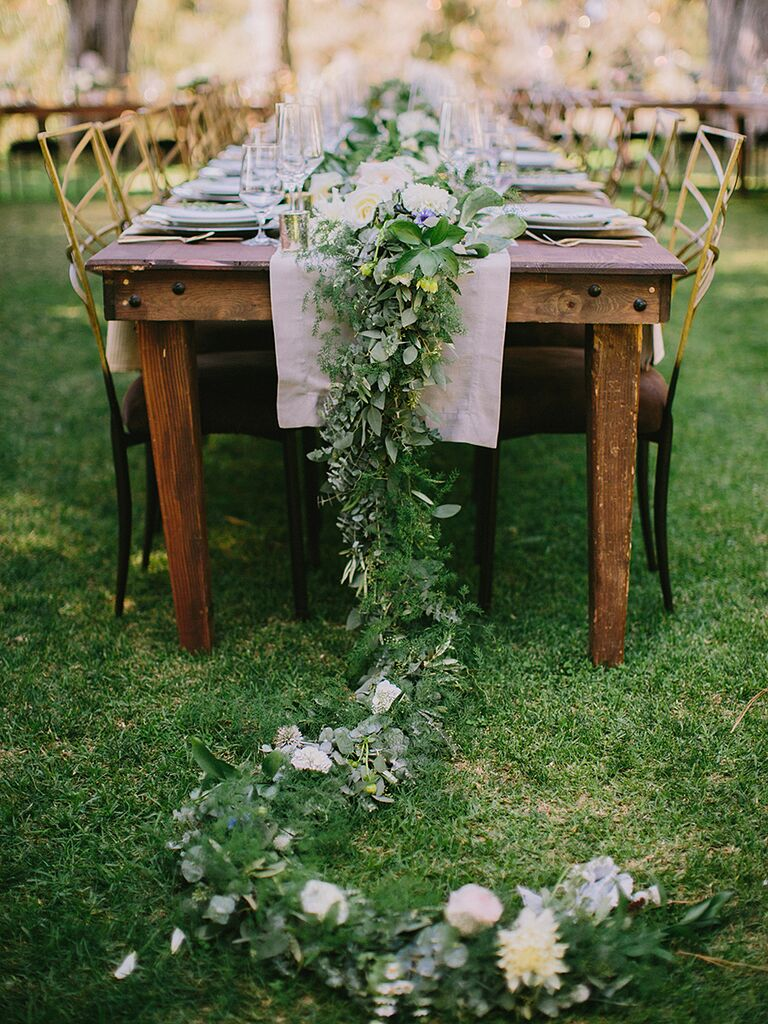 Rustic centerpiece idea with a low, lush garland and flowers