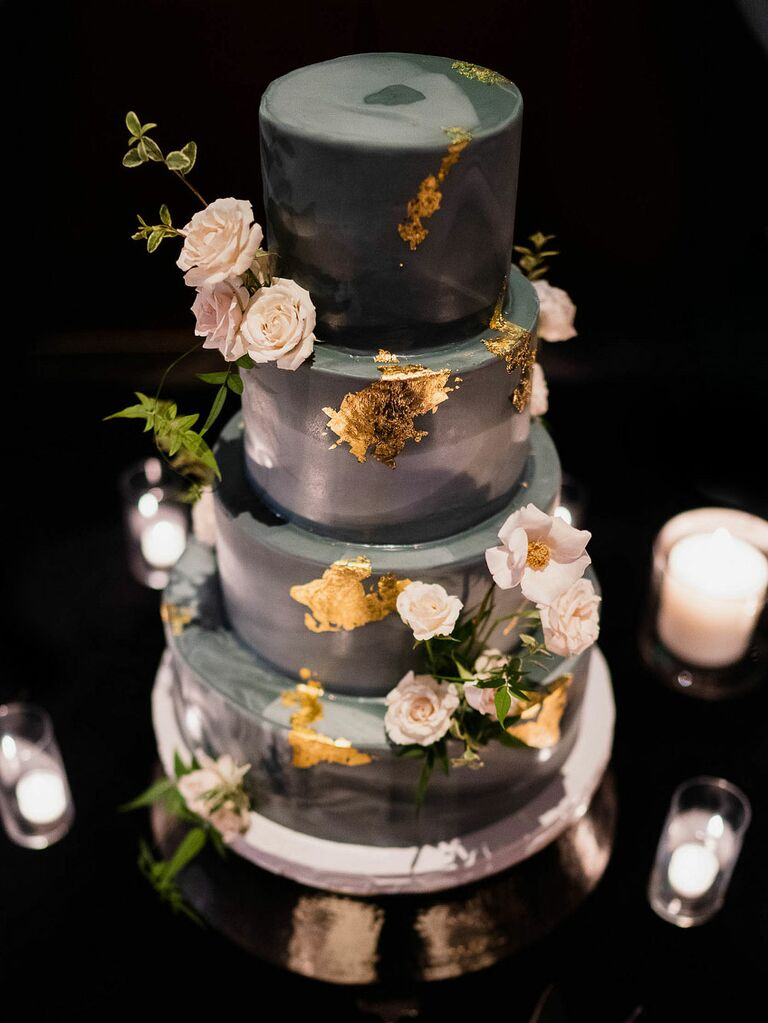 Black and gray ombré wedding cake with flowers and gold leaf foil