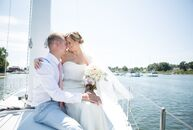 Inspired by their waterfront venue (that was also the  groom's childhood home), Khrysty Griswold (27, a product manager) and Dylan Mark (33, a sailmak