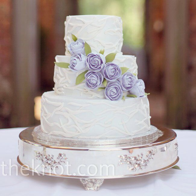 Pale lavender icing almost made the cake look white against the lavender sugar roses and soft green leaves.