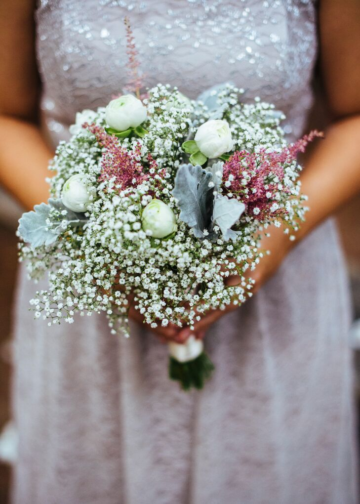 The bridesmaids carried a soft, romantic bouquet of baby's breath with white ranunculus and dusty miller.