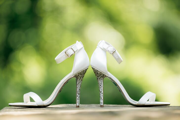 Melissa wore Betsy Johnson white heels with silver crystal-embellished heels.
