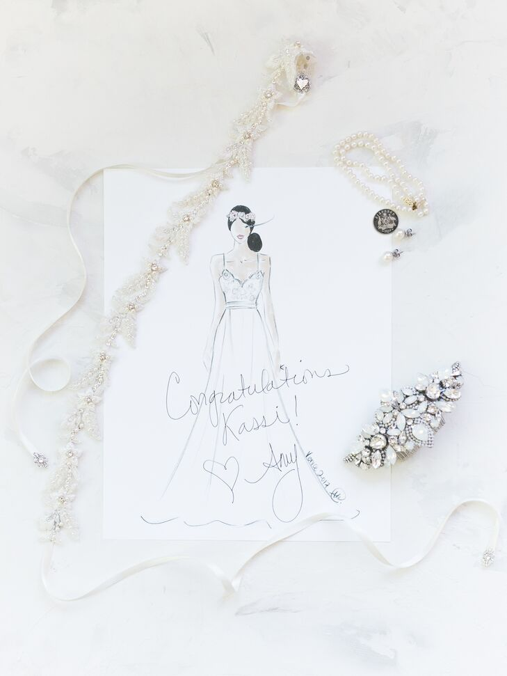 Kassi incorporated several family heirlooms into her look, including a double strand pearl bracelet, a pearl comb and a sash.
