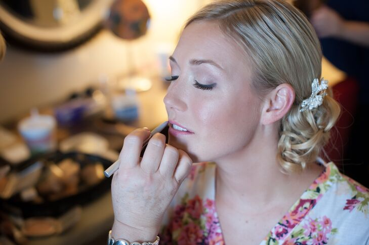 Marguerite had her makeup applied on site after her curled side-bun updo was complete. Her soft eyelashes and light pink lips brought out the delicate, romantic feel of her wedding look.