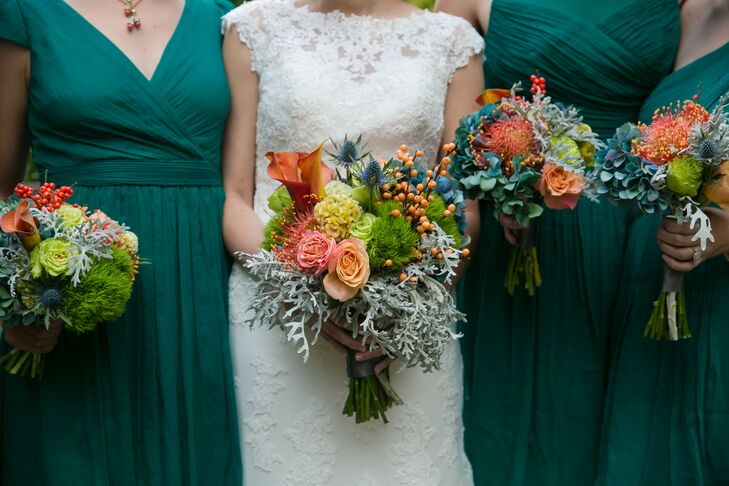 """With a mid-October wedding date, a fall-inspired theme felt fitting for Laura and Daniel's elegant affair. To keep the theme from feeling to over-the-top, the couple stuck with a palette of green, navy and gold and used flowers to introduce a few bursts of bright, cheerful color throughout. """"We wanted the decor to reflect autumn without hitting you over the head with it,"""" Laura says. """"We wanted things to feel natural and organic. The venue itself is so beautiful to begin with and we wanted to make sure we were just adding subtle touches and not hiding what was already there."""""""