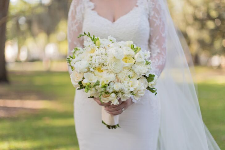 "Amanda wanted her wedding to be filled with lush white and green flowers and carried a full bouquet of peonies and garden roses. ""Kato Floral Designs was beyond amazing,"" says Amanda. ""They were probably my favorite vendor from the Savannah area that I worked with!"""