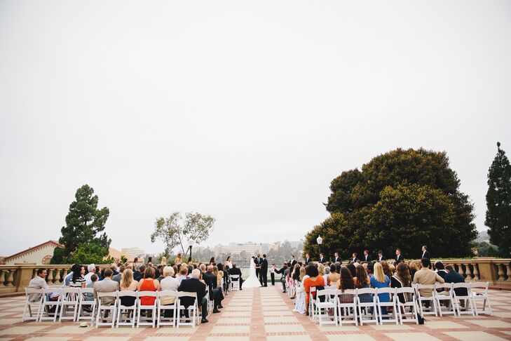 """""""The only thing needed at the ceremony were the chairs! No aisle runner, archway and flower decor. All natural beauty, simple and elegant,"""" says the couple."""