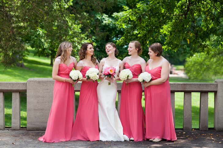 The bridesmaids wore bright coral floor-length dresses, with coral cuffed bracelets and coral stud earrings.