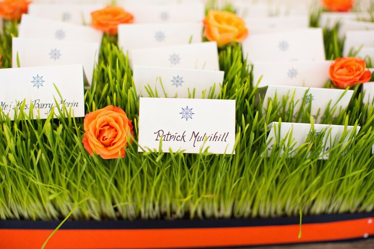 Nautical-themed escort cards were set in a fun grassy display accented by bright orange roses.