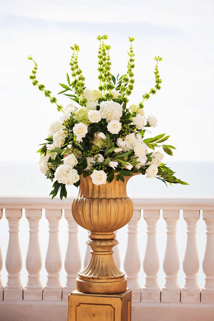 White Floral Arrangement In Gold Vase