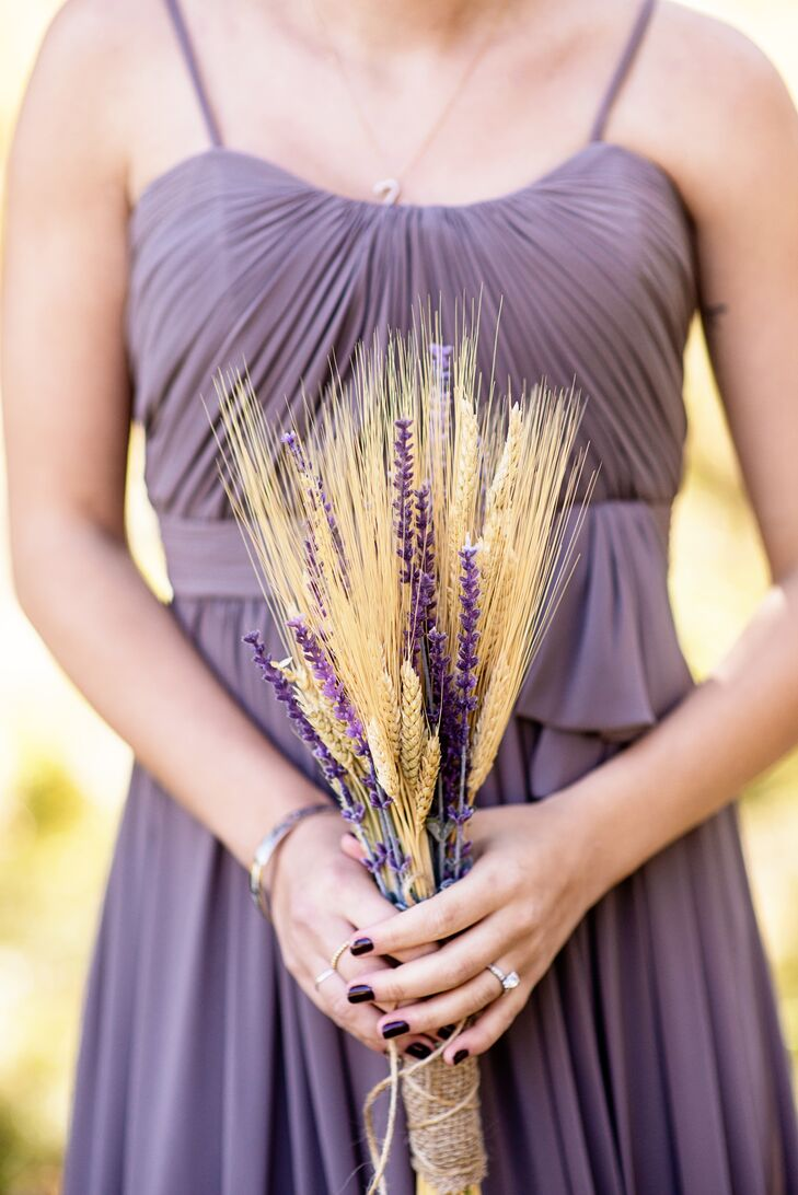 The bridesmaids carried wheat and lilac bouquets, adding to the vintage, rustic theme.