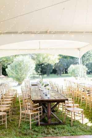 Tent with Gold Chiavari Chairs in Springfield, Missouri