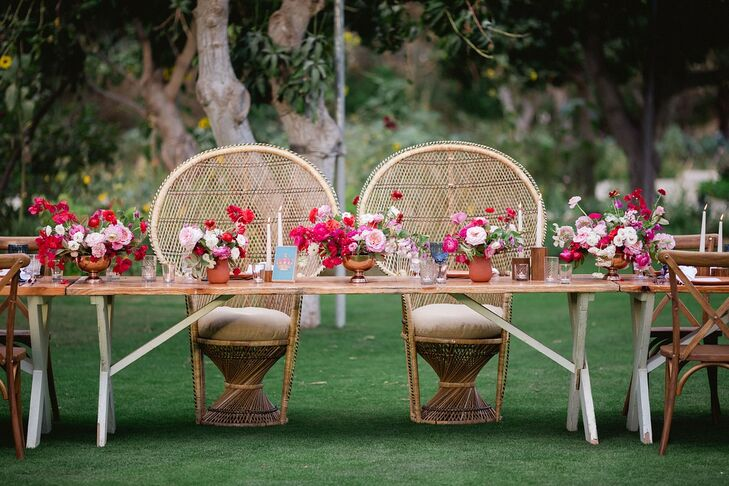 Head Table with Pink Flower Centerpieces and Wicker Sweetheart Chairs
