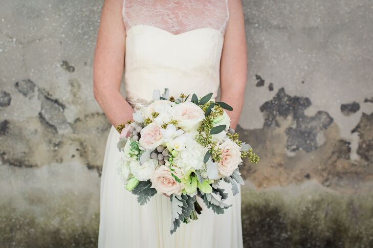 Alex complemented the couple's vintage decor with a bouquet of blush roses, white hydrangea, seeded eucalyptus, silver brunia and dusty miller.