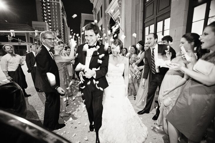 As the couple made their way from the reception, their family and friends tossed ivory rose petals.