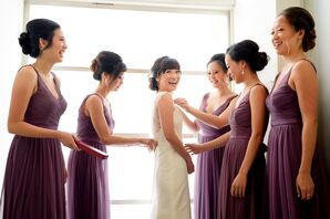 Bridesmaids in Purple Dresses Helping Bride Get Ready