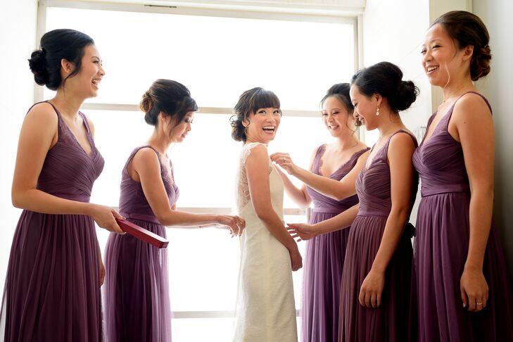 Bridesmaids in Purple Dresses Helping Bride Get Ready