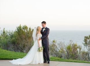 The outdoor ceremony site with surrounding ocean views, combined with the indoor ballroom embodying elegance and charm, provided
