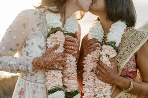 Couple With Henna and Marigold Garlands Kissing
