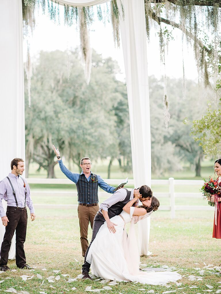 Simple draped ivory fabric arch for an outdoor wedding