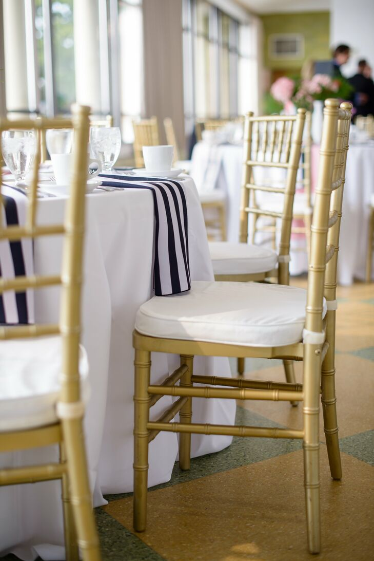 A traditional black, white, blush and gold color scheme with stripe accents created a classic-yet-nautical feel.