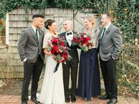Bride and groom with wedding party at holiday wedding