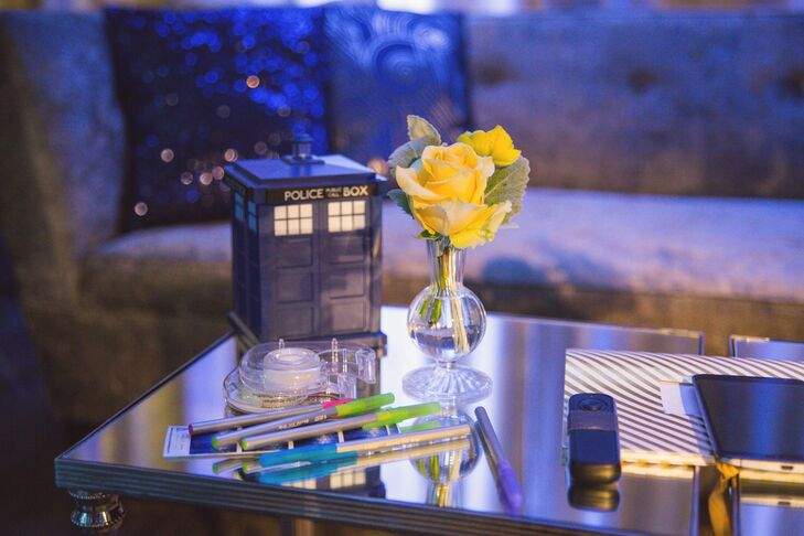 Coffee Table With Tardis Figurine and Yellow Rose