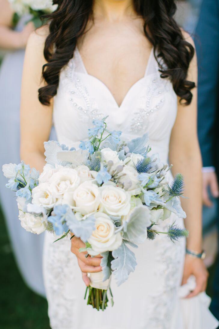 pale blue delphinium thistle and dusty miller bouquet