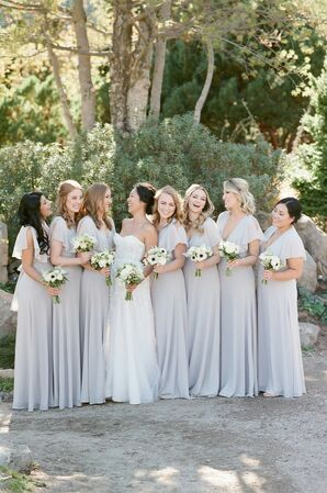 Classic Bridesmaids with Long Gray Dresses and White Bouquets