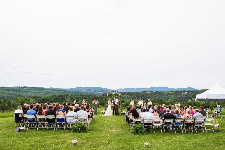 "Amy and Tyler wanted to keep things simple when it came to their wedding day, with Vermont's natural beauty serving as the main inspiration for all the decor. A barn seemed like the ideal backdrop for the rustic affair, and after several venue visits, the pair finally came across the Inn at Mountain View Farm in East Burke, Vermont, and were instantly taken by its serene setting and country charm. ""The view from the outdoor ceremony site was incredible,"" Amy says. ""And there is an animal sanctuary on the property, with horses, donkeys, goats and cows. The reception took place in a very traditional barn. Some of the guest tables were even in stalls."""