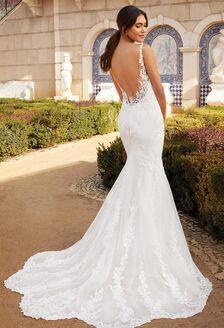 bride in spaghetti strap A-line wedding dress with groom