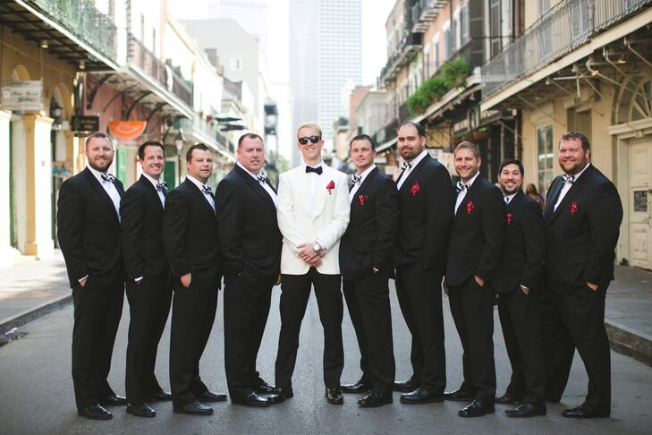 The groom and his attendants matched the wedding's crisp black-and-white color palette in classic tuxedos.