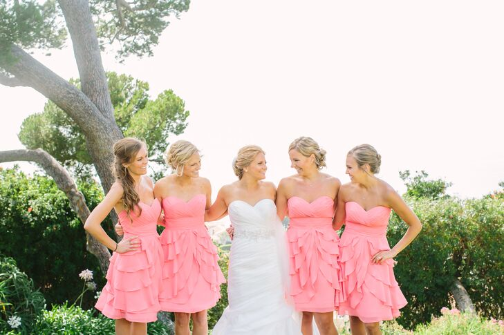 """""""The bridesmaids wore layered chiffon coral dresses with a ruched sweetheart neckline by Allure,"""" says Brittney. """"I finished off their look with an infinity symbol gold necklace to represent how important each one of them is to us."""""""