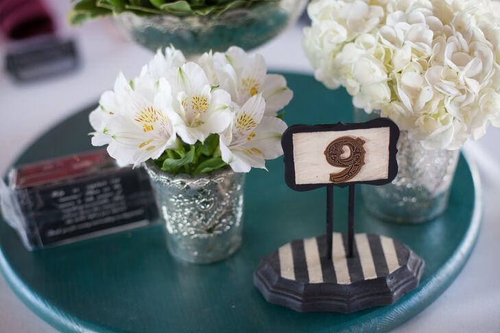 The bride even went so far as to DIY her table numbers -- using homemade stencils and scrapbook stickers to create the unique, bold detail.