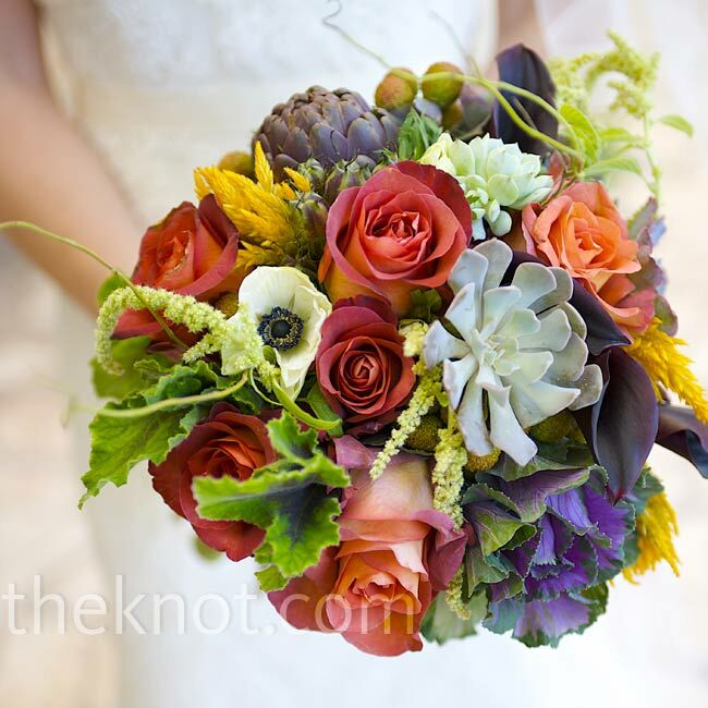 Emily's bouquet was filled with anemones, roses, succulents, and more. She had her grandmother's antique brooch pinned to the stems for a personal touch.