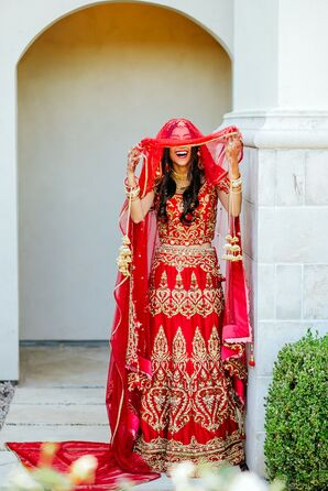 Bride in Traditional Red Attire and Veil